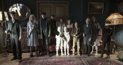 DF-12584 - The residents of MISS PEREGRINE'S HOME FOR PECULIAR CHILDREN ready themselves for an epic battle against powerful and dark forces. Left to right: Enoch (Finlay Macmillan), Emma (Ella Purnell), Jake (Asa Butterfield), Hugh (Milo Parker), Bronwyn (Pixie Davies), the twins (Thomas and Joseph Odwell), Claire (Raffiella Chapman), Fiona (Georgia Pemberton), Horace (Hayden Keeler-Stone), Olive (Lauren McCrostie), and Millard (Cameron King). Photo Credit: Jay Maidment.